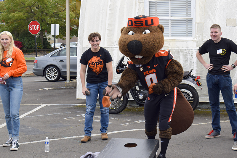 Benny the Beaver playing Cornhole