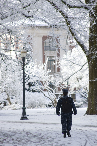 midshipman walking to class in the snow