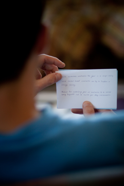 student reading index card